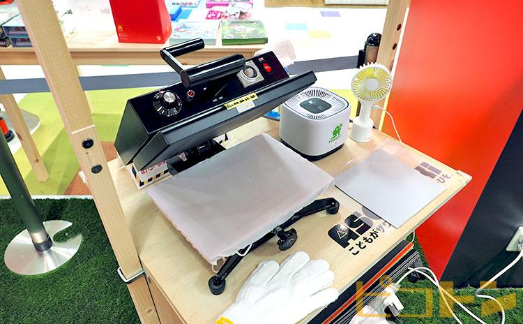 アートタオルはスタッフが専用のアイロンプレス機で仕上げます。